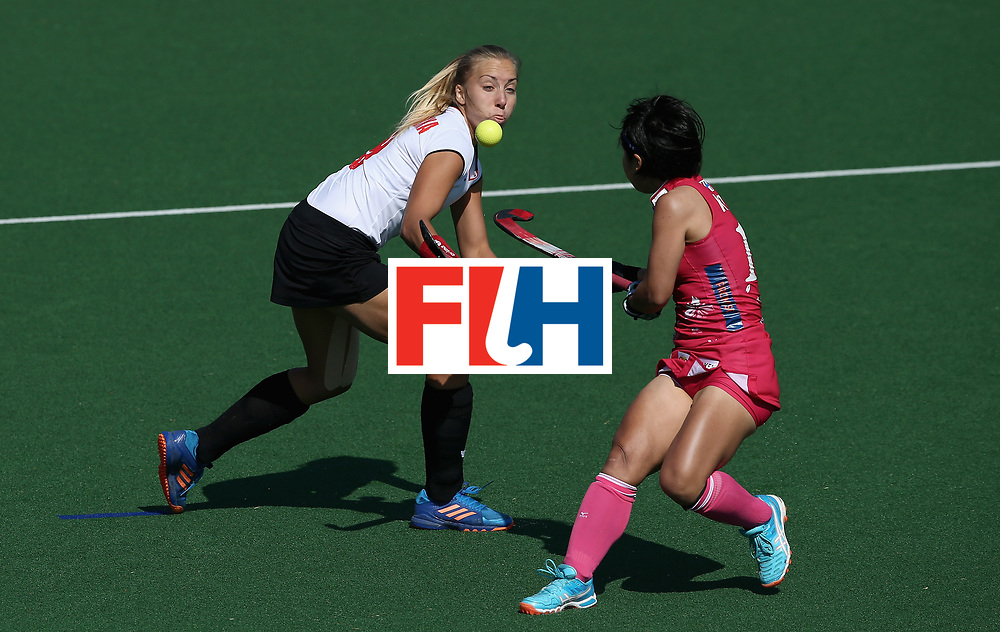 JOHANNESBURG, SOUTH AFRICA - JULY 14:  Martyna Wypijewska of Poland and Akiko Kato of Japan battle for possession  during day 4 of the FIH Hockey World League Semi Finals Pool B match between Poland and Japan at Wits University on July 14, 2017 in Johannesburg, South Africa.  (Photo by Jan Kruger/Getty Images for FIH)
