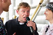 A vicar makes a speech at a festival wedding,  Boomtown, Matterley Estate, Alresford Road, Winchester, Hampshire, UK, August, 2010