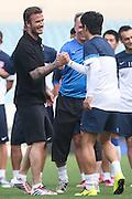 NANJING, CHINA - JUNE 18: (CHINA OUT) <br /> <br /> David Beckham Visits Jiangsu Sainty Football Club<br /> <br /> David Beckham shakes hands with Jiangsu Sainty player during his meeting with Jiangsu Sainty players at Nanjing Olympic Sports Centre on June 18, 2013 in Nanjing, Jiangsu Province of China.<br /> ©Exclusivepix