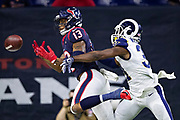 HOUSTON, TX - AUGUST 29:  Tyron Johnson #13 of the Houston Texans has a pass knocked away by Darious Williams #31 of the Los Angeles Rams during week four of the preseason at NRG Stadium on August 29, 2019 in Houston, Texas. The Rams defeated the Texans 22-10.   (Photo by Wesley Hitt/Getty Images) *** Local Caption *** Tyron Johnson; Darious Williams