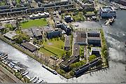 Nederland, Noord-Holland, Amsterdam, 09-04-2014;<br /> Marineterrein en Kattenburg (boven), Scheepvaartmuseum. Dijksgracht en spoorbaan beneden.<br /> Navy area and the National Maritime Museum (white building).<br /> luchtfoto (toeslag op standard tarieven);<br /> aerial photo (additional fee required);<br /> copyright foto/photo Siebe Swart