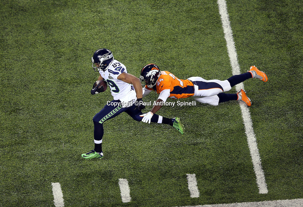Seattle Seahawks wide receiver Doug Baldwin (89) catches a third quarter pass good for a gain of 37 yards and a first down at the Denver Broncos 6 yard line while chased by Denver Broncos cornerback Champ Bailey (24) during the NFL Super Bowl XLVIII football game against the Denver Broncos on Sunday, Feb. 2, 2014 in East Rutherford, N.J. The Seahawks won the game 43-8. ©Paul Anthony Spinelli