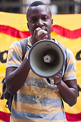 Zimmerman's trial began on June 10, 2013, in Sanford. On July 13, 2013, he was found not guilty of second-degree murder and of manslaughter charges of Trayvon Martin.<br /> Demonstrator speaks on the megaphone outside the American Embassy to protest the recent Trayvon Martin's Verdict,<br /> London, United Kingdom<br /> Tuesday, 16 July 2013<br /> Picture by Piero Cruciatti / i-Images