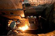 Repair on a mining machine in an underground coal mine in Illinois. ©Peoria Journal Star/David Zalaznik