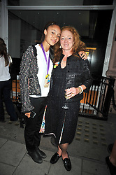 Left to right, ADWOWA ABOYAH and CAMILLA LOWTHER at the opening of his pop up shop at 35 South Audley Street, London W1 on 19th September 2009.