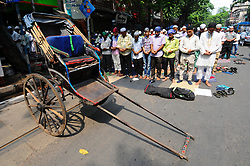 June 2, 2017 - Kolkata, West Bengal, India - Indian Muslim devotees offer Friday prayers and a hand Rickshaw stand by at the Kolkata Road side on the first Friday of Ramadan in Kolkata on June 02,2017.Muslims throughout the world are marking the month of Ramadan, the holiest month in the Islamic calendar during which Muslims fast from dawn until dusk. (Credit Image: © Debajyoti Chakraborty/NurPhoto via ZUMA Press)