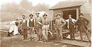 This photo depicts a Northern Pacific section crew. 1890  The unidentified crew members and, what appears to be family, seem to have put in a hard day's work.