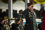 29 SEPTEMBER 2014 - NAKHON NAYOK, NAKHON NAYOK, THAILAND: General PRAYUTH CHAN-OCHA salutes as Thai soldiers march past him at the retirement ceremony for Prayuth and 200 other generals. Gen. Prayuth Chan-ocha led the 22 May coup against the civilian government earlier this year. Prayuth has been chief of the Thai army since 2010. After his retirement, Gen. Prayuth will retain his posts as head of the junta's National Council for Peace and Order (NCPO) and Prime Minister of Thailand. Under Thai law, military officers must retire at 60 years of age. The 200 generals who retired with Prayuth were also his classmates at the Chulalomklao Royal Military Academy in Nakhon Nayok.    PHOTO BY JACK KURTZ