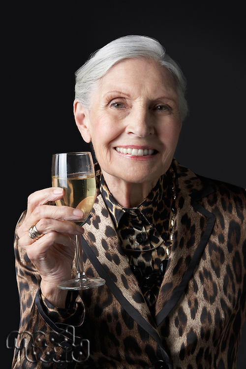 Senior woman with glass of white wine