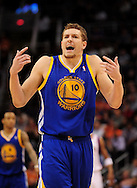 Feb. 10, 2011; Phoenix, AZ, USA; Golden State Warriors forward David Lee (10) reacts on the court against the Phoenix Suns at the US Airways Center. Mandatory Credit: Jennifer Stewart-US PRESSWIRE