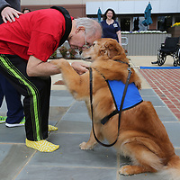 """Jack Balty, left, thanks """"Charlie"""" for helping with his rehab Wednesday at North Mississippi Medical Center in Tupelo."""