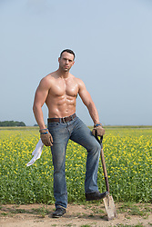 shirtless muscular farmer outdoors