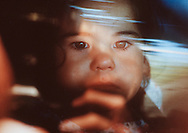 Baby Jessica, the center of a bitter two-year custody fight between the adoptive parents and the biological father, looks out the car window as she is taken from the only family she has known.