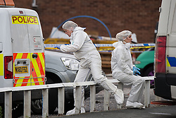 © Licensed to London News Pictures . 22/08/2016 . Salford , UK . Crime scene on Atkinson Road , Urmston , Greater Manchester , where a man has been found dead and a woman was seen staggering through the street covered in blood , this afternoon (22nd August 2016) . Police tasered and then detained a man at the scene . Photo credit : Joel Goodman/LNP