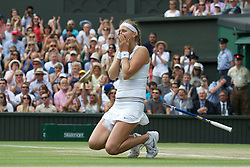 LONDON, ENGLAND - Saturday, July 2, 2011: Petra Kvitova (CZE) collapses to her knees as she celebrates after winning the Ladies' Singles Final on day twelve of the Wimbledon Lawn Tennis Championships at the All England Lawn Tennis and Croquet Club. (Pic by David Rawcliffe/Propaganda)