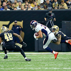 Nov 13, 2016; New Orleans, LA, USA;  Denver Broncos running back Devontae Booker (23) is tackled by New Orleans Saints strong safety Kenny Vaccaro (32) during the first half of a game at the Mercedes-Benz Superdome. Mandatory Credit: Derick E. Hingle-USA TODAY Sports