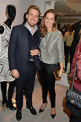 HARRY & CHARLOTTE LAWSON-JOHNSTON at a party at Herve Leger, Lowndes Street, London on 12th November 2014 to view the latest collection.