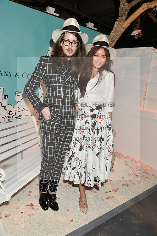 JOSHUA KANE and BETTY BACHZ at the Tiffany & Co. Exhibition 'Fifth And 57th' Opening Night held in The Old Selfridges Hotel, Orchard Street, London on 1st July 2015.