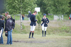 Zara Phillips (GBR) makes a call after placing second<br /> CCI4* Luhmuhlen 2013<br /> © Hippo Foto - Jon Stroud