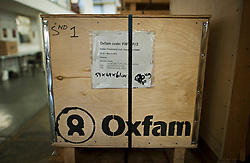 © London News Pictures. 14/11/2013. Bicester, UK. A container carrying water treatment equipment. Humanitarian aid bound for Cebu, in the Philippines, being loaded onto lorries at the Oxfam Emergency Warehouse in Bicester, Oxfordshire. Cebu was one of the areas hardest hit by Typhoon Haiyan, which has killed thousands of people.  Photo credit: Ben Cawthra/LNP