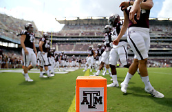 Members of Texas A&M's football team warmup before the start of an NCAA college football game against UCLA Saturday, Sept. 3, 2016, in College Station, Texas. (AP Photo/Sam Craft)