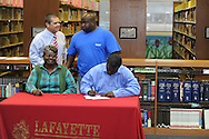 Lafayette High's D'Andre Greer (62) signs a National Letter of Intent to play football at Itawamba Community College in Oxford, Miss. on Wednesday, February 1, 2012.