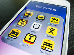 Detail of iPhone screen with many mobile apps for booking taxis