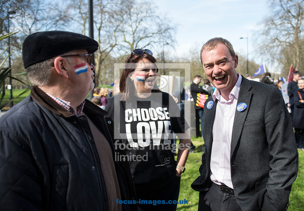 Tim Farron, leader  of the Liberal Democrats, has announced he is standing down in the wake of the General Election.  Westminster, London<br /> Picture by Daniel Hambury/Stella Pictures Ltd 07813022858<br /> 14/06/2017<br /> <br /> SPL TIM FARRON MP 11.jpg<br /> <br /> Original Caption:<br /> Tim Farron MP speaks to a member of the public at Unite for Europe march, starting in Park Lane and ending in a rally in Parliament Square.<br /> Picture by Daniel Hambury/Stella Pictures Ltd 07813022858<br /> 25/03/2017