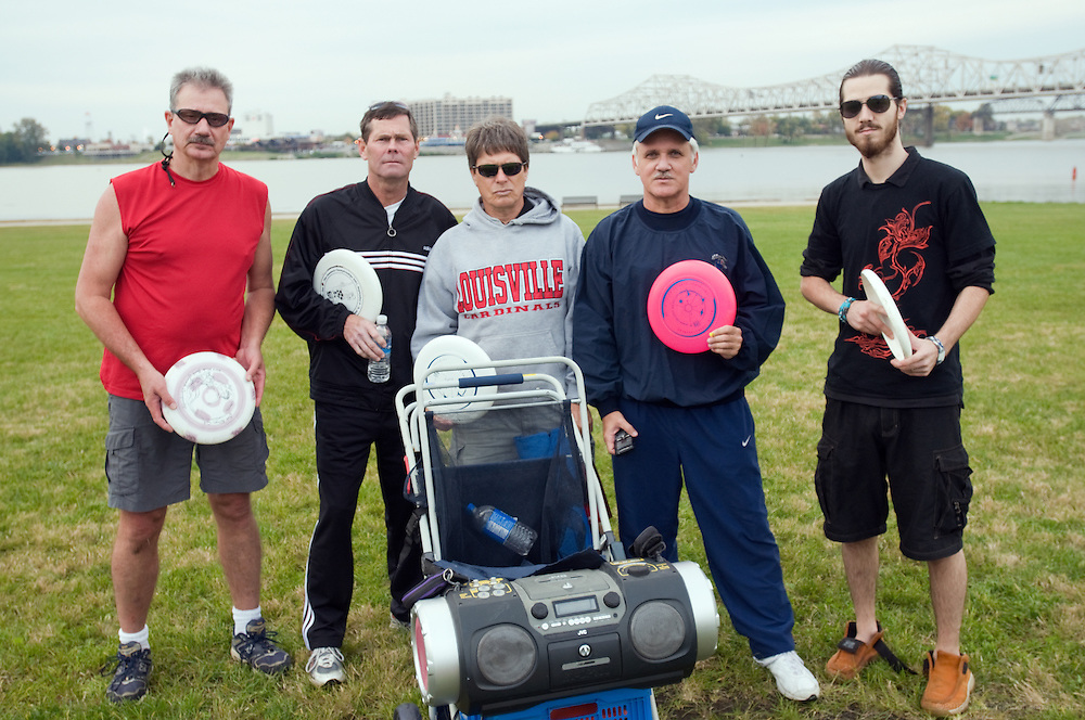 Grimly, from left, Rik Downs, Corky Gillis, David Greenwell, Stuart Arnold and Aaron Luhrs. Photos from the Peanut Butter and KY Jelly Jam Thursday Oct. 21, 2009 on the Great Lawn in Louisville, Ky. A gathering of Kentucky flying disc freestyle greats instigated by Rik Downs, Corky Gillis and Stuart Arnold flew in from Lexington and Disc golf legend David Greenwell showed up for an evening jam along the Ohio River. Then an Ultimate Frisbee player, Aaron Luhrs, who'd never jammed before, came along and experienced freestyle enlightenment. (Photo by Brian Bohannon)