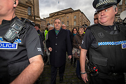 Alex Salmond leaves the High Court towards the Court of Session to speak to his legal team.