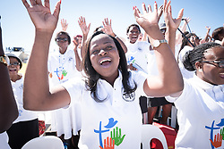 """14 May 2017, Windhoek, Namibia: Lilie Shikongo sings in the choir, as thousands of Lutherans and guests gathered for a festival of worship, witness and song and word and sacrament in Sam Nujoma Stadium on Sunday, May 14th to mark commemoration of the 500th Anniversary of the Lutheran Reformation in Windhoek, Namibia. Marking the Reformation as global citizen, the worship event drew music, stories, and leadership from the churches of every continent. The service formed a high point of the Twelfth Assembly of the Lutheran World Federation, in Windhoek, Namibia, on 10-16 May 2017, under the theme """"Liberated by God's Grace"""", bringing together some 800 delegates and participants from 145 member churches in 98 countries."""