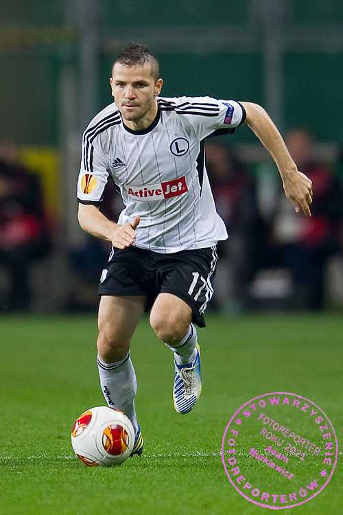 Legia's Tomasz Brzyski controls the ball during the UEFA Europa League Group J football match between Legia Warsaw and Trabzonspor AS at Pepsi Arena Stadium in Warsaw on November 07, 2013.<br /> <br /> Poland, Warsaw, November 07, 2013<br /> <br /> Picture also available in RAW (NEF) or TIFF format on special request.<br /> <br /> For editorial use only. Any commercial or promotional use requires permission.<br /> <br /> Mandatory credit:<br /> Photo by &copy; Adam Nurkiewicz / Mediasport