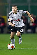 Legia's Tomasz Brzyski controls the ball during the UEFA Europa League Group J football match between Legia Warsaw and Trabzonspor AS at Pepsi Arena Stadium in Warsaw on November 07, 2013.<br /> <br /> Poland, Warsaw, November 07, 2013<br /> <br /> Picture also available in RAW (NEF) or TIFF format on special request.<br /> <br /> For editorial use only. Any commercial or promotional use requires permission.<br /> <br /> Mandatory credit:<br /> Photo by © Adam Nurkiewicz / Mediasport