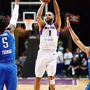 Reno Bighorns Guard AARON HARRISON (1) shoots from outside against Oklahoma City Blue Forward RASHAWN THOMAS (5) during the NBA G-League Basketball game between the Reno Bighorns and the Oklahoma City Blue at the Reno Events Center in Reno, Nevada.