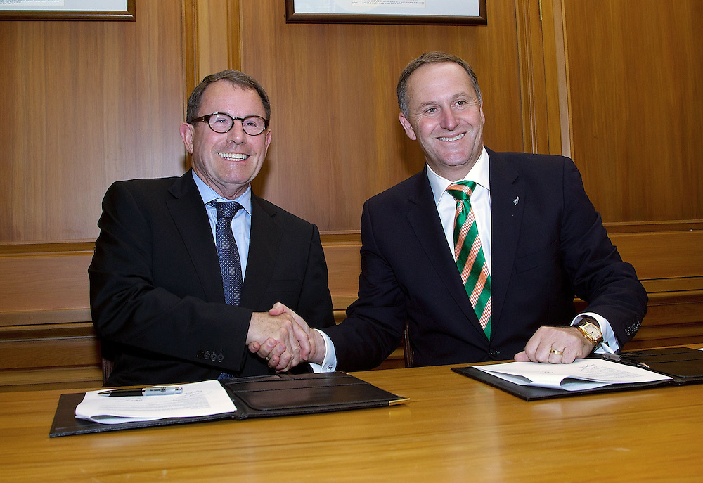 New Zealand Prime Minister John Key, right, with ACT MP John Banks sign a coalition agreement at Parliament in Wellington, New Zealand, Monday, December 05, 2011. Credit: SNPA / Marty Melville