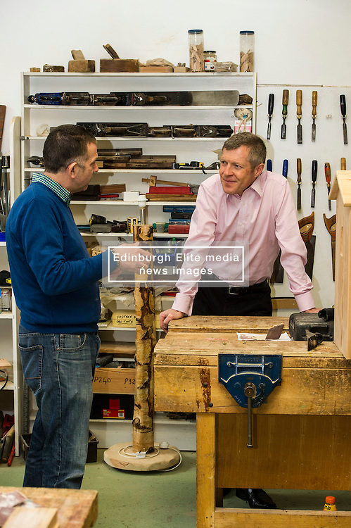 Pictured: Willie Rennie, was shown round the woodworking room by Senior manager Tommy Steel.<br /> <br /> Scottish Liberal Democrat leader Willie Rennie met staff and customers at the Grassmarket café, part of the Grassmarket Community Project, as he visited the Edinburgh social enterprise today as part of his election campaign. He took the opportunity to set out Lib Dem student support plans ahead of an NUS election hustings in Glasgow. <br /> Ger Harley | EEm 11 April 2016