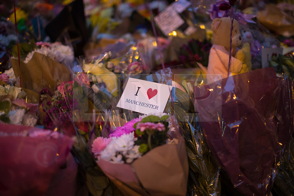 © Licensed to London News Pictures . 29/05/2017 . Manchester , UK . Mourners pay their respects ahead of a vigil at 10:31pm in St Ann's Square in Manchester City Centre , exactly a week after Salman Abedi murdered 22 and injured another 64 at an Ariana Grande concert at Manchester Arena . Photo credit: Joel Goodman/LNP