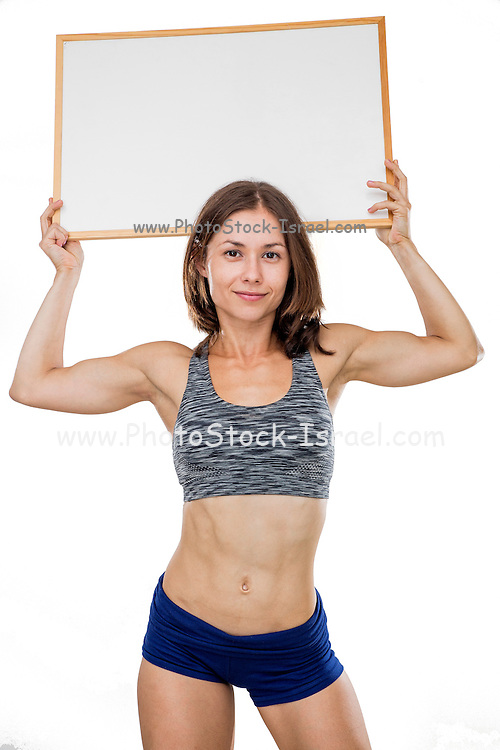 female bodybuilder holds a blank whiteboard ready for your own message Model release available