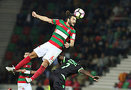 Maritimo´s player Erdem Sen heads the ball during the  Portuguese First League football match Maritimo vs Sporting held at Barreiros Stadium, Funchal, Portugal, 21 January, 2017.  EPA / GREGÓRIO CUNHA