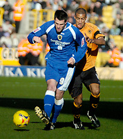 Photo: Ed Godden/Sportsbeat Images.<br />Wolverhampton Wanderers v Cardiff City. Coca Cola Championship. 20/01/2007. Cardiff's Steven Thompson (L), is challenged by Karl Henry.