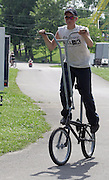 David W. Smith/ Daily News<br /> Kyle Kiesel, 14, from Evansville, IN, rides a six-foot tall bike he and a friend welded during the Hot Rod Reunion Thursday at Beech Bend Campground.