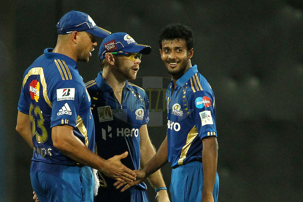 Andrew Symmons, Adrian Blizzard and Abu Nechim Ahmed celebrate the wicket of Michael Hussey during match 3 of the NOKIA Champions League T20 ( CLT20 )between the Chennai Superkings and the Mumbai Indians held at the M. A. Chidambaram Stadium in Chennai , Tamil Nadu, India on the 24th September 2011..Photo by Ron Gaunt/BCCI/SPORTZPICS