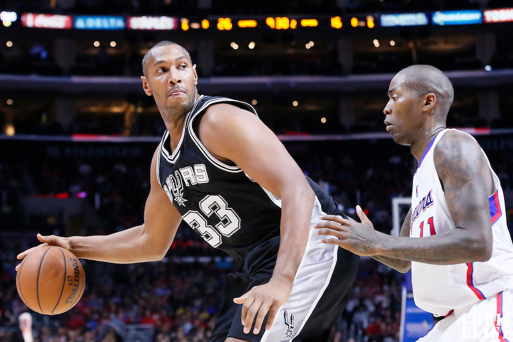 10 November 2014: San Antonio Spurs forward Boris Diaw (33) posts up Los Angeles Clippers guard Jamal Crawford (11) during the San Antonio Spurs 89-85 victory over the Los Angeles Clippers, at the Staples Center, Los Angeles, California, USA.