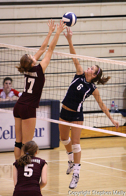 Xavier junior Alex Saxen (6) tips the ball just over the hands of Mt Vernon junior Courtney Kintzel (17) in their match at the Westside Volleyball Invitational at Jefferson High School in Cedar Rapids on Saturday October 10, 2009. Mt Vernon won the match 21-7, 21-17.