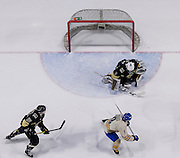 21 February 2015:  UBC forward Manraj Hayer (9) scores on Manitoba goalie Byron Spriggs (1) as Manitoba forward Chad Robinson (15) looks on during a CIS Men's Hockey - Canada West Quarter-Final Playoffs.  Game #3 (best of 3) between the University of British Columbia Thunderbirds and the University of Manitoba Bisons at Mitchell Arena, University of British Columbia, Vancouver, BC, Canada.    ****(Photo by Bob Frid/UBC Athletics) 2015 All Rights Reserved****