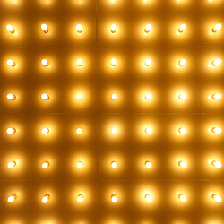 Theater lights in rows high resolution photo. Image is vertical and is available as a stock photo, poster or print.