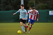 Dorking Wanderers James McShane in action against Lewes FC Ronnie Conlon during the Ryman League - Div One South match between Dorking Wanderers and Lewes FC at Westhumble Playing Fields, Dorking, United Kingdom on 28 January 2017. Photo by Jon Bromley.