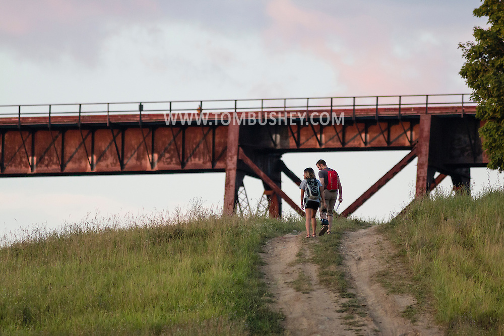 Cornwall, New York - A couple walk on a path toward the Moodna Viaduct railroad trestle on  on July 24, 2015.