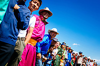 Crowds watch the horse races at the traditional Naadam festival in Tsagaannuur, northern Mongolia.