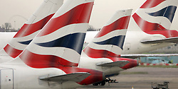 File photo dated 30/11/2006 of tail fins of British Airways' aircraft parked at Temrinal One of London's Heathrow Airport. Talks are continuing on Thursday over the fate of thousands of British Airways workers who face being laid off because of the coronavirus crisis.